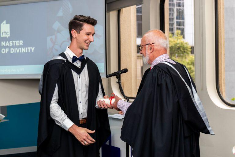 Reuben Capill receiving Diploma